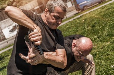 Self defense techniques against a gun