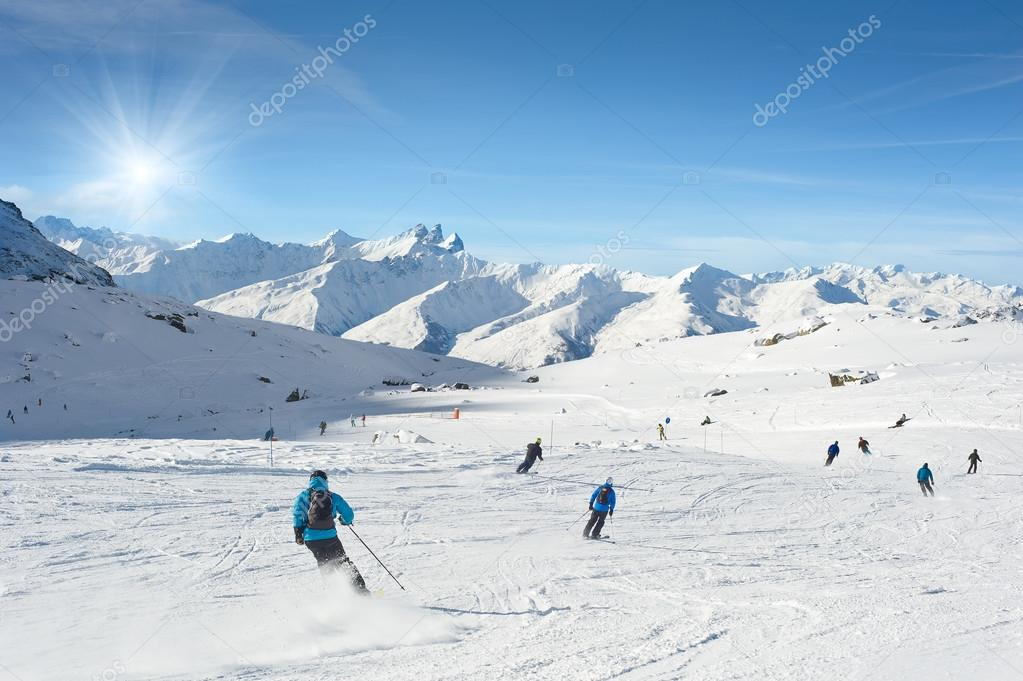 Skiers enjoy in the mountain on a s
