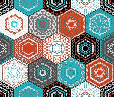 Coloured embroidered hexagons background.