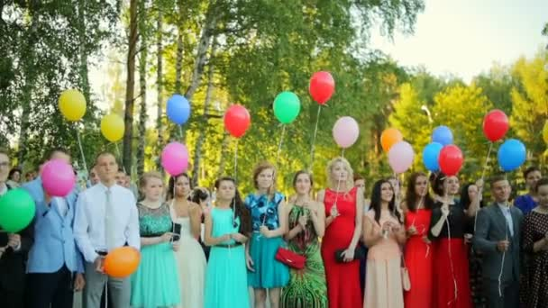 Russia, Novosibirsk, 2015: School graduation. Graduates are released into the air balloons