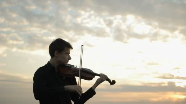 Musician playing violin on the roof, classic music.