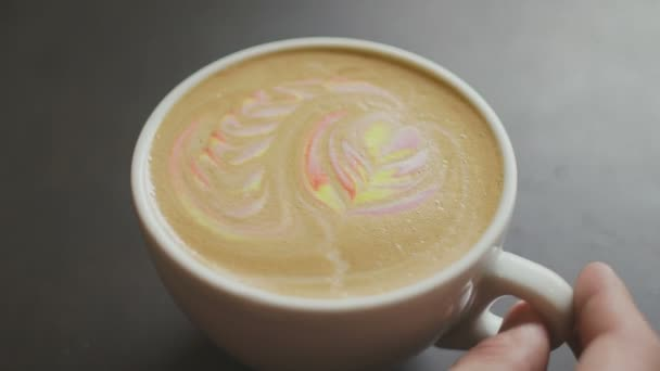 Unknown flips mug with colorful rainbow latte