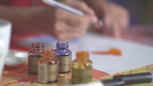 Artist dry painting and drawing new elements. Drawing lessons