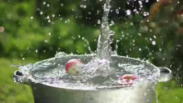 Apple splashing into water in slowmotion