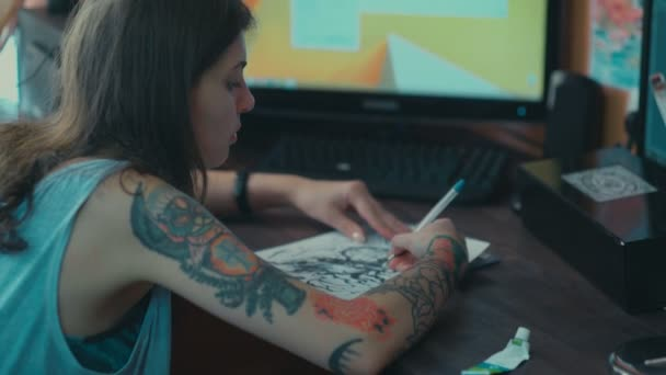 Sketch future tattoos. The girl with a tattoo on her arm