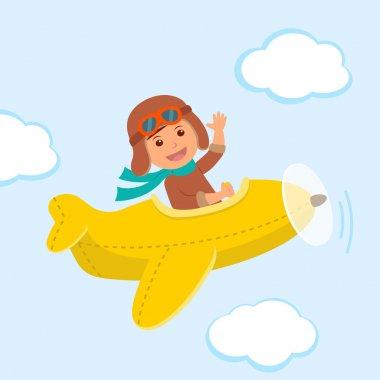 Cute boy pilot flies on a yellow plane in the sky. Air adventure
