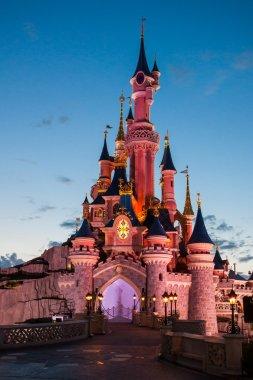 Disneyland Paris Castle illuminated at sunset
