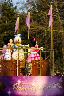 Mickey Mouse and friend during Disney Once Upon a Dream Parade
