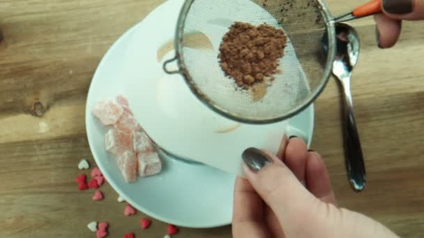 Female makes Coffee art decoration with sheet