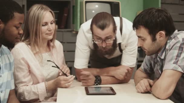 Mix-raced group of businesspeople using tablet