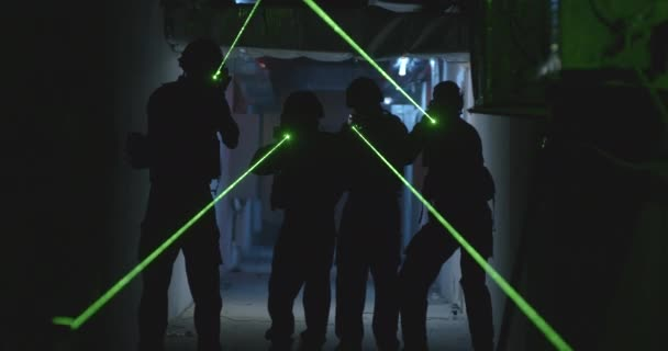 SWAT team with laser sights in dark corridor