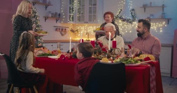 Loving family celebrating Christmas at home