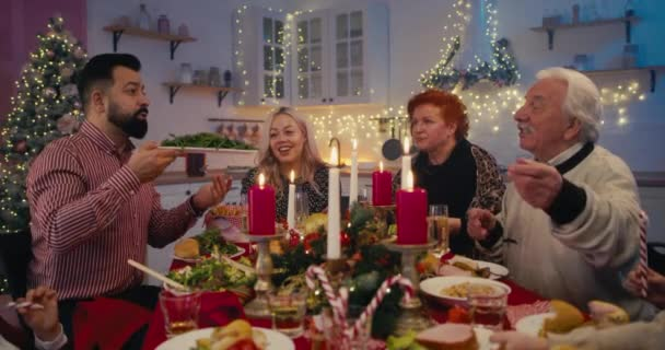 Loving family sharing delicious meal on Christmas day