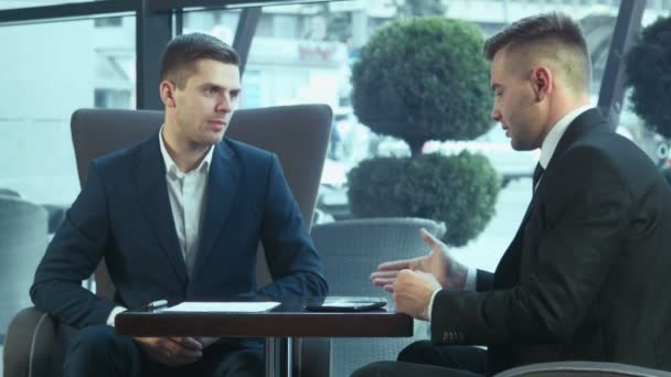 dialog of businessmans using touchpad