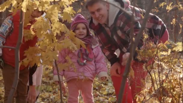 The happy family walks in park
