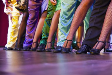 dancer legs performing on stage in colorful costumes
