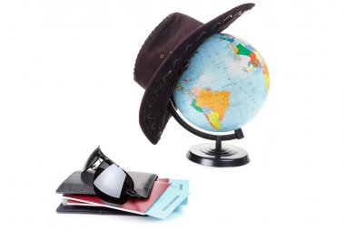 Passports, tickets, globe as a vacation concept. Summer journey preparation. Holidays, checking documents, choosing destination point, having fun.