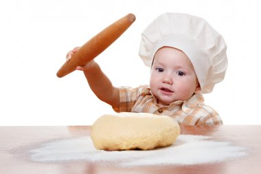 Cute kid rolls cook pizza dough. Isolated on white background