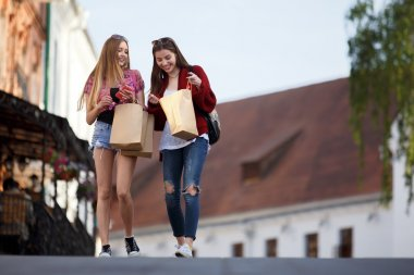 Attractive women walking on the street after shopping