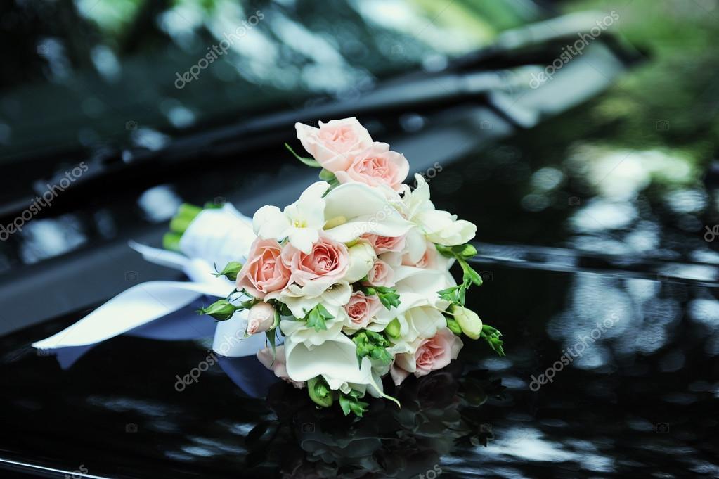 Wedding bouquet on a black hood