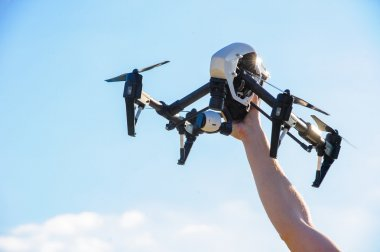 Drone with camera in man hand