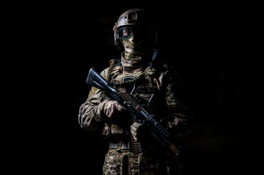 Military man in a mask and with a submachine gun
