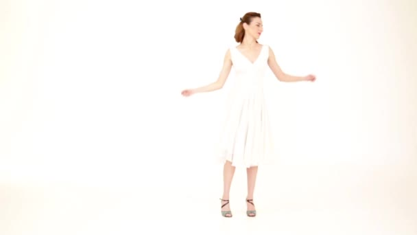 woman spinning around in a beautiful white dress, on white background