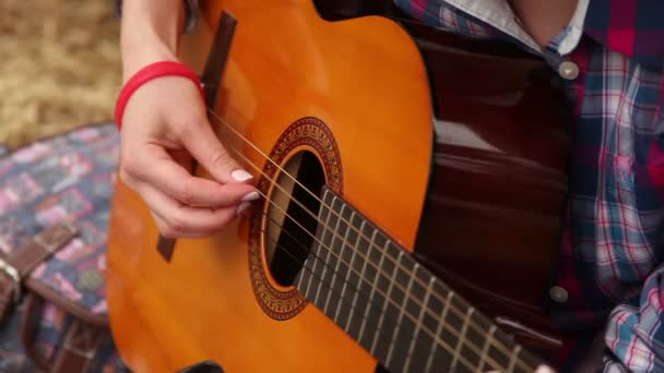 Girl composes music with a guitar.