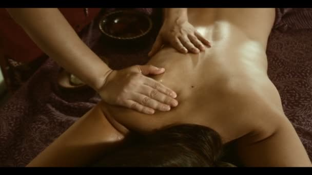 Beautiful Young Woman Receiving Massage  Spa. Multiethnic woman relaxing at spa center