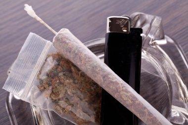 Close up of marijuana and smoking paraphernalia