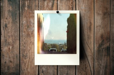 Instant photo frame on wall.Polaroid-style image
