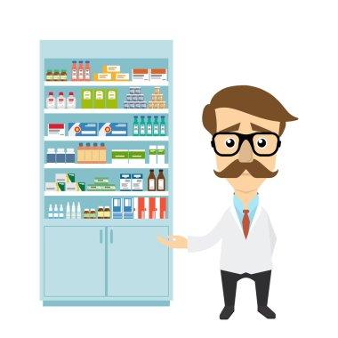 Health care. Male pharmacist in pharmacy opposite shelves with medicines