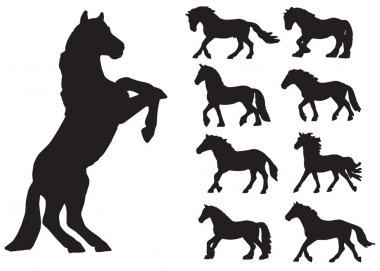 set of silhouettes of horses