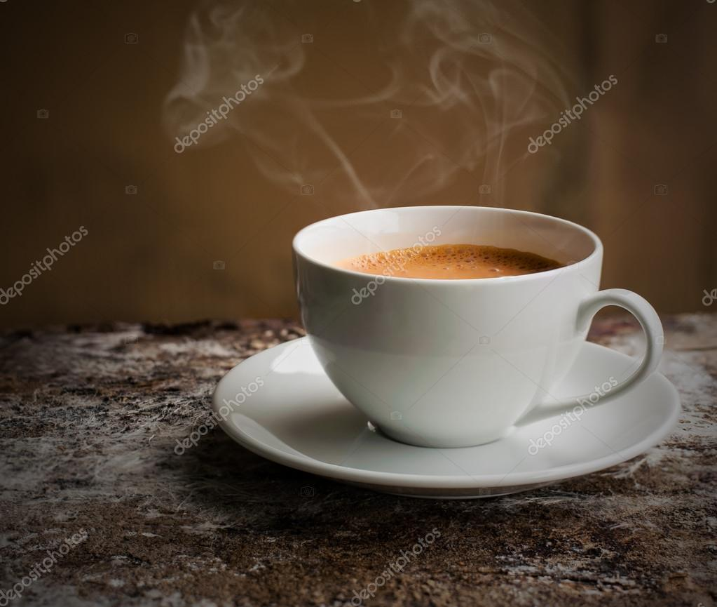 Cup of coffee with smoke in still life ton