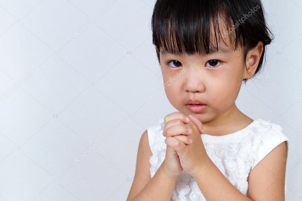Asian girls praying