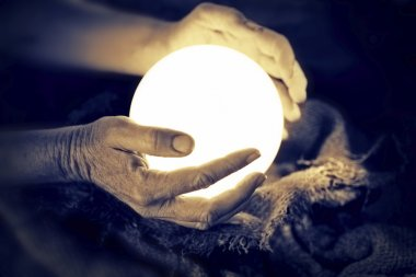 Crystal ball in human hands