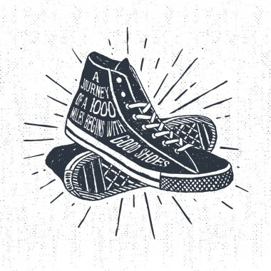 Hand drawn inspirational travelling badge with sneakers.
