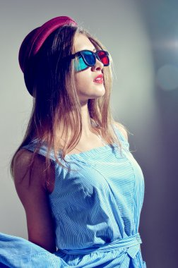 Girl in 3d glasses thoughtfully looking