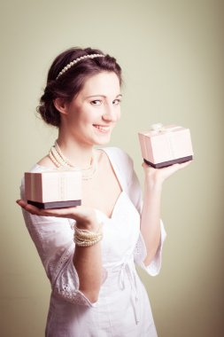 Holding present boxes up elegant beautiful young lady in white dress