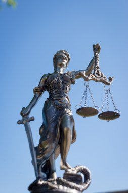 picture of sculpture of themis, femida or justice goddess on bright blue sky outdoors copy space background