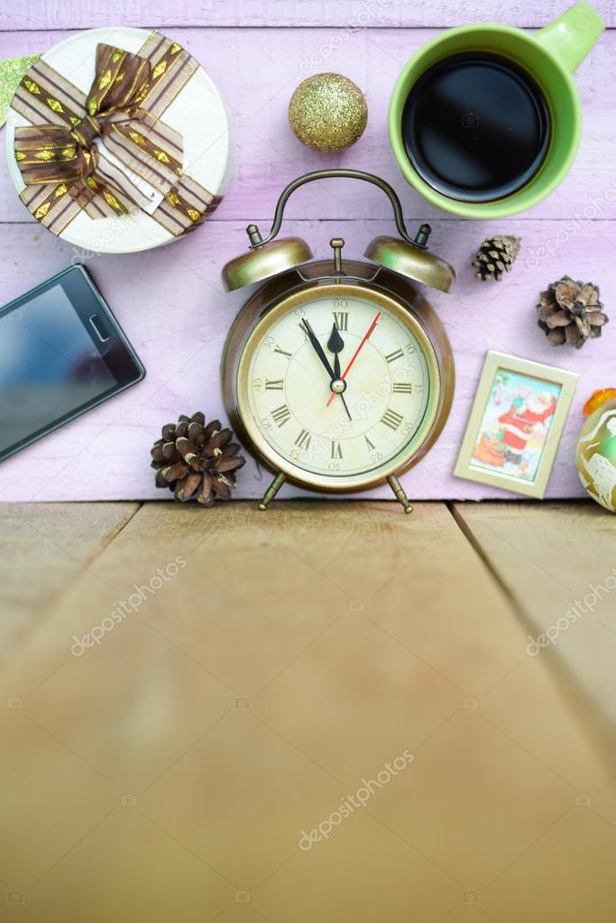 Picture of coffee cup, alarm clock and christmas decorations on wooden background copy space