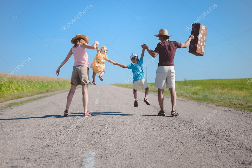silhouette of family joyful walking on the countryside rural road on sunny blue sky outdoors background, copy space picture