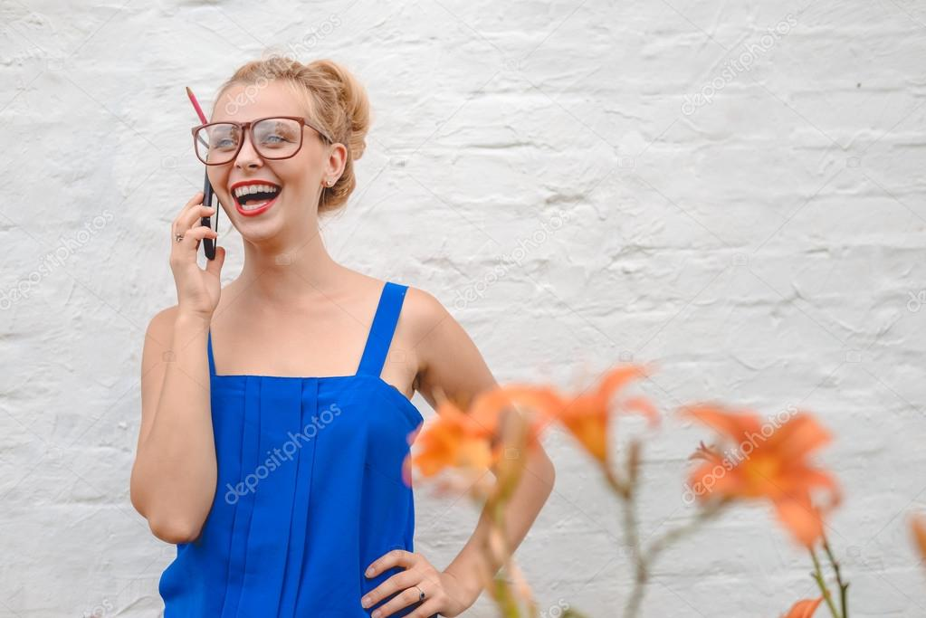 Picture of pretty girl in big glasses speaking phone