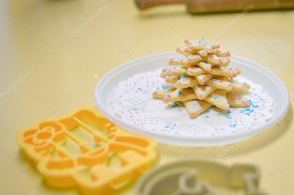 image closeup of christmas cookies laying on white plate