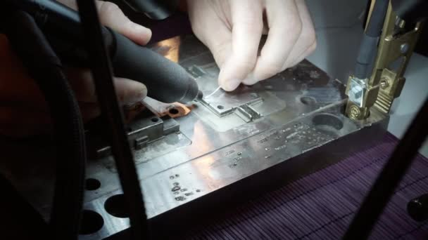 Soldering the part by the master to repair the product