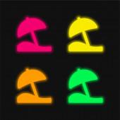 Beach deštník čtyři barvy zářící neonový vektor ikona