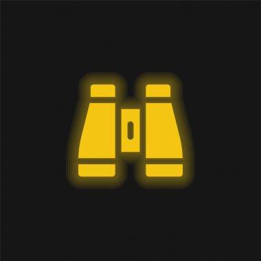 Binoculars yellow glowing neon icon stock vector