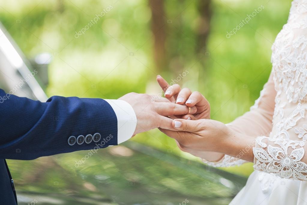 The couple exchange wedding rings Stock Photo 3kstudio 121117952