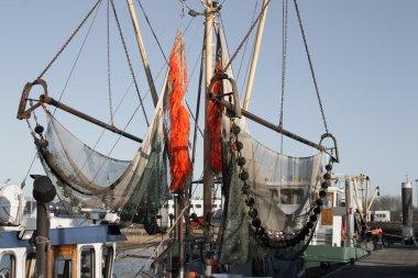 Fishing net with orange ropes hanging