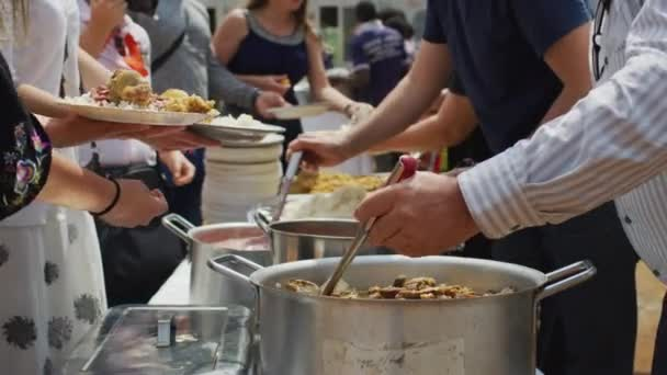 People serving food in cafe